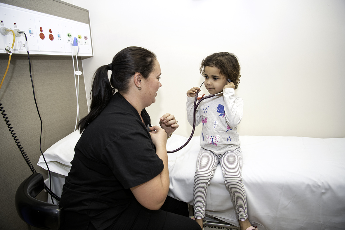 Dr Sarah Goddard with child patient